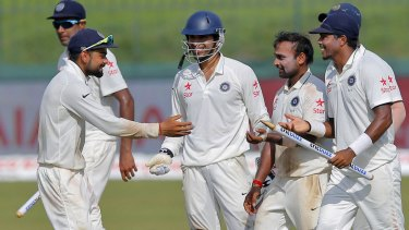 Indian captain Virat Kohli celebrates with his teammates after defeating Sri Lanka in the third Test to clinch the series 2-1.