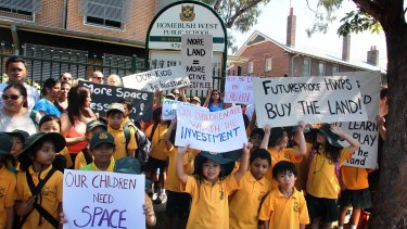 Parents and children protest at Homebush West Public school where children have been banned from running due to overcrowding.