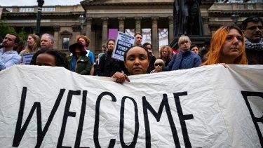 We're still waiting. Melburnians rallied at the ''Close Manus, Close Nauru, Bring Them Here!'' rally.