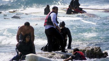 Migrants, who are trying to reach Greece, are rescued by members of the Greek Coast guard and locals near the coast of the southeastern island of Rhodes on  April 20.