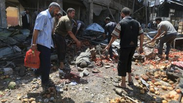 The scene at a marketplace in Douma after air strikes hit on Sunday.
