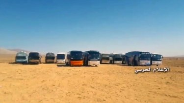 Buses gathering before a planned evacuation of Islamic State group militants, in the mountainous region of Qalamoun, Syria.