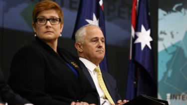 Prime Minister Malcolm Turnbull launches his 2016 Defence white paper with Defence Minister Marise Payne backed by just two Australian flags.