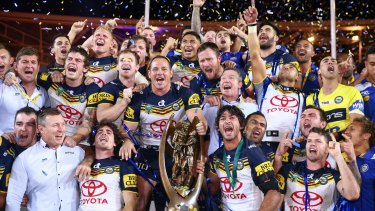 Title to defend: The Cowboys celebrate on the podium with the premiership trophy after winning the 2015 NRL Grand Final match over the Brisbane Broncos. Will North Queensland win again in 2016?