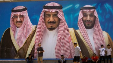 A billboard showing King Salman, centre, his son Mohammed bin Salman,  right, and former heir Mohammed bin Nayef in Taif, Saudi Arabia.