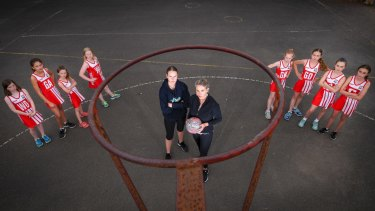 Carly Kluge, president of the Parkside Netball Club, with players.