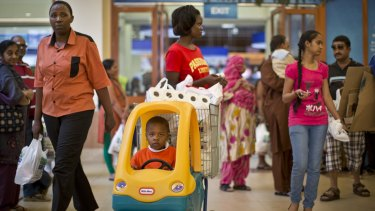 Shoppers visit the reopened Westgate mall on Saturday.