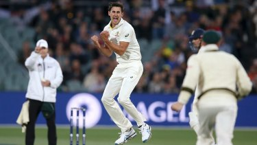 First blood: Mitchell Starc jumps for joy after dismissing Mark Stoneman.