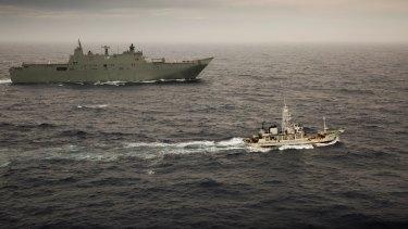 HMAS Adelaide escorts the former Japanese whaling vessel towards Hobart in December.
