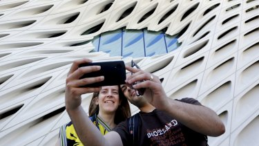 """Pedro Cadima takes a selfie of himself and his wife Eva in front of the Broad Museum's """"oculus"""" window in Los Angeles."""