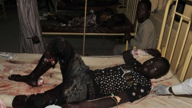 The injured receive treatment at a local hospital following an explosion at a mobile phone market in Kano, Nigeria on Wednesday.