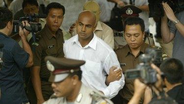 Myuran Sukumaran is escorted to court in Denpasar, Bali, in October 2005.