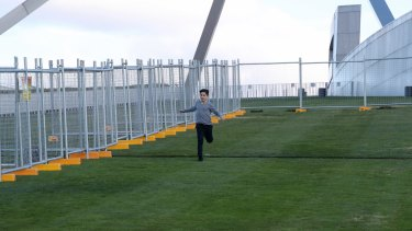 A temporary fence is installed at Parliament House in preparation for the building of a permanent security fence.