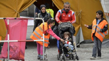 A refugee family is given candy as they arrive at Munich Hauptbahnhof railway station.