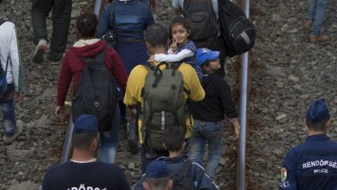 A smile of hope from a Syrian girl on the move in Hungary.