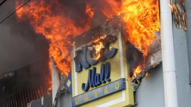 A fire rages on at a shopping mall in Davao on Saturday.