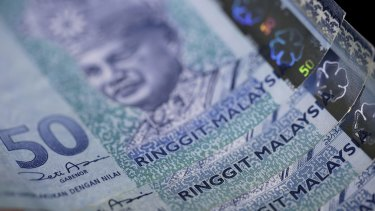 Malaysia's currency, the ringgit, has plunged as the ongoing political scandal, China's yuan devaluation and slumping oil prices take their toll.