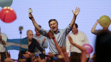 Opposition presidential candidate Mauricio Macri celebrates with supporters at his campaign headquarters in Buenos Aires, Argentina, on Sunday.