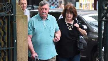 Oliver Lyttle enters court with an unidentified woman.