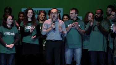 Adam Bandt  addresses supportersat an election night party.