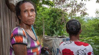 Filomena Gomes and her sister at their home in the slums encircling Dili.