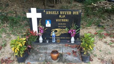 """A commemorative stone for Wayne Schneider at the """"Angel's Place"""" bar and Hells Angels members-only compound in Pattaya. Schneider was a top former member."""