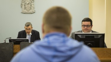 Magistrate Tony Parsons speaks to a drug court participant in Dandenong last year.