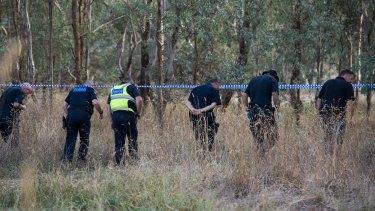 Police search bushland near where Mr Tennant was shot.