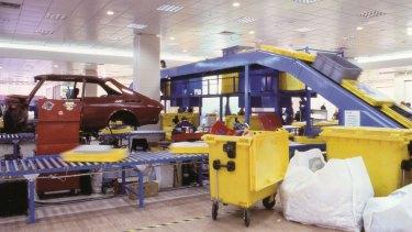 A conveyor belt sent Michael Landy's possessions for destruction.