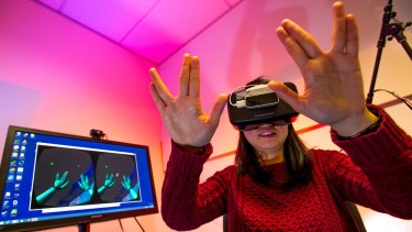 Universities are using virtual reality googles to teach students like Shan He subjects such as medicine and science.