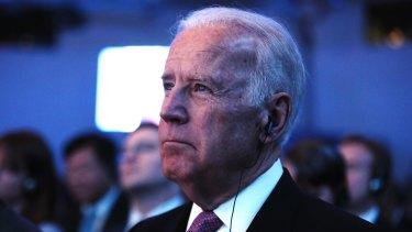 US Vice-President Joe Biden listens as Chinese President Xi Jinping speaks.