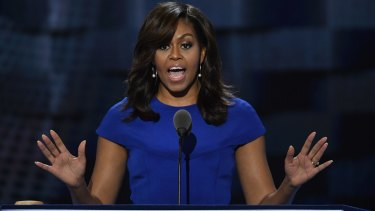 Michelle Obama speaks during the convention, a rare moment when the crowd was united in its adulation.