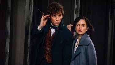 Eddie Redmayne and Katherine Waterston inhabit a world that is quite different to the <i>Harry Potter</i> series.