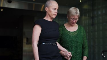 Ashley Bryant's wife Deborah (left) leaves the NSW Coroner's Court in Glebe on Wednesday.