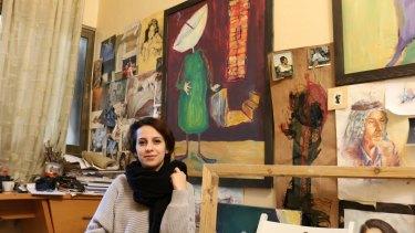 Majdal Nateel, 28, a Palestinian artist, in her studio in Gaza.