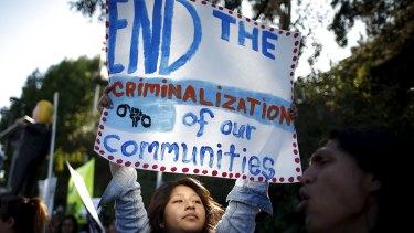 Nancy Rosales Hernandez, 23, protests outside a Donald Trump speech venue in Los Angeles.