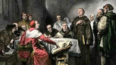 Martin Luther is depicted in a monk's habit standing before his accusers at the Diet of Worms in 1521.