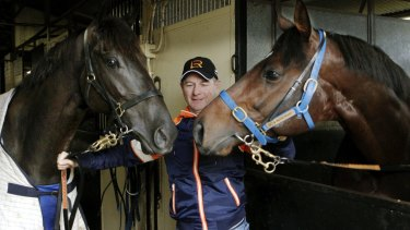 Trainer Kris Lees with gallopers Lucia Vallentina (left)  and Protectionist.