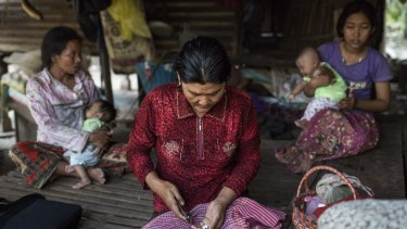 A woman prepares antiretroviral medication for her HIV-positive mother in Roka, Cambodia. They will never receive the attention or treatment enjoyed by Charlie Sheen.