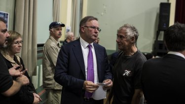 Mr Albanese was heckled by WestConnex opponents who blame him for offering funds for the motorway when he was transport minister.