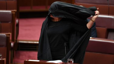 Pauline Hanson removes her burqa after the Senate stunt.