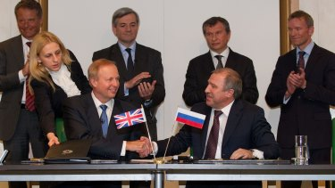 BP Chief Executive Bob Dudley (left) with state-run Rosneft's then President Eduard Khudainatov (right) after they signed an agreement to form their arctic strategic alliance in 2011. BP is Russia's largest foreign investor.
