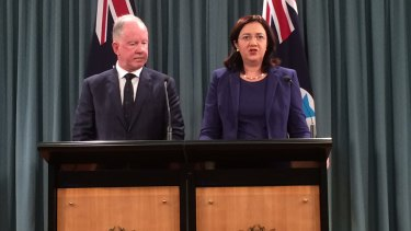 Commissioner Michael Byrne, with Premier Annastacia Palaszczuk during the handing down of the report.
