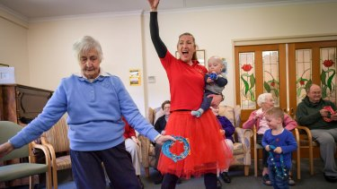 Sonja Olsen (in the red skirt) runs an intergenerational playgroup in Melbourne's east.