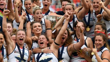Reason to celebrate: The Adelaide Crows players after winning the grand final.