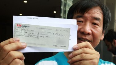 Cleaner Anping Yan leaving court with the cancelled cheque.