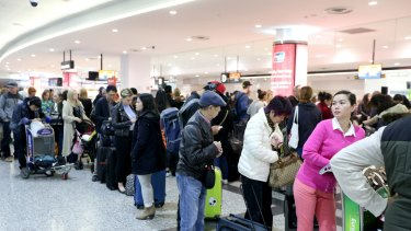 Passengers are seen waiting in long queues as a result of Australian Border Force staff holding a two-hour strike at Melbourne Airport last year.