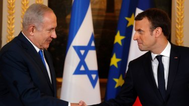French President Emmanuel Macron, right, and Israeli Prime Minister Benjamin Netanyahu in Paris on Sunday.