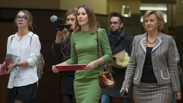 Russian celebrity TV host Ksenia Sobchak, centre, also wants to challenge Russian President Vladimir Putin in the March 18 presidential election.