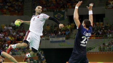 Qatar's Marko Bagaric, from Croatia, left, tries to score past France's Ludovic Fabregas during the men's preliminary handball match between France and Qatar in Rio on Tuesday.